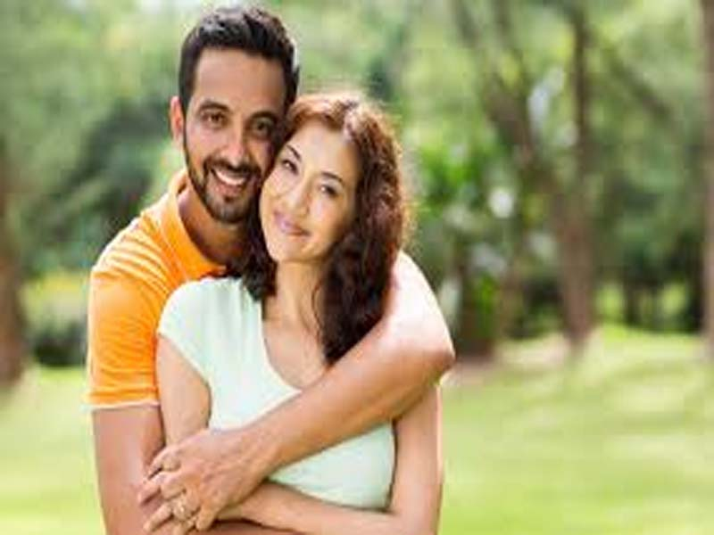 Couple Posing with Beautiful Smile in Garden - December Born Couples