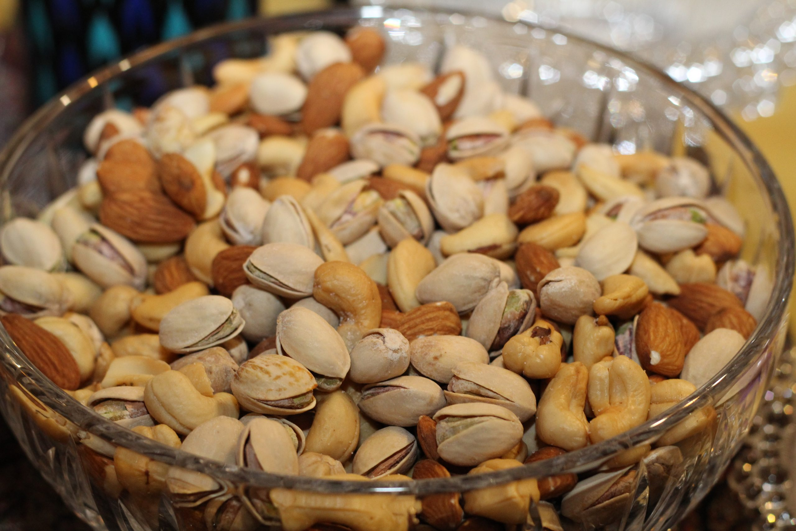 A glass bowl is full of Nuts | Breast size reduction